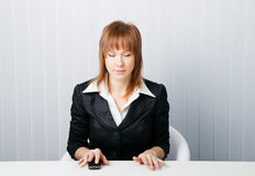 Attractive business woman meditating Stock Photos