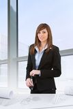 Attractive business woman in office Royalty Free Stock Photo