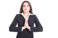 Attractive business woman praying isolated on white Royalty Free Stock Photos