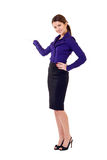 Attractive business woman presenting. Business woman presenting something imaginary over white Royalty Free Stock Image