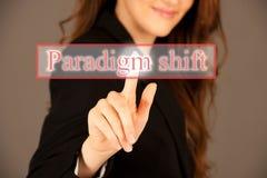 Attractive business woman pressing a virtual button. Attractive business woman pressing paradigm shift virtual button Stock Photos