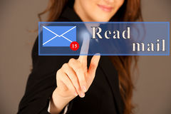 Attractive business woman pressing a virtual button read mail.  Stock Images