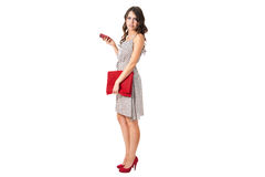 Attractive business woman with a red purse Stock Photography