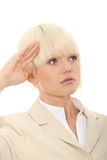 Attractive business woman saluting Stock Photos