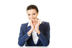 Attractive business woman showing heart sign. Isolated on white Royalty Free Stock Images