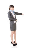 Attractive business woman showing or introducing Stock Photos