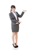 Attractive business woman showing or introducing Stock Photography
