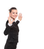 Attractive business woman is showing okay sign with happiness. Young smiling woman showing OK Stock Photos