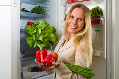 Attractive business woman showing vegetables for healthy eating Stock Photos