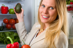 Attractive business woman showing vegetables for healthy eating Stock Photo