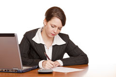 Attractive business woman signing contract. Attractive business woman sitting in office and signing contract. Isolated on white background Stock Photography