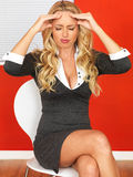 Attractive Business Woman Sitting in a Chair Stressed and with a headache Royalty Free Stock Images