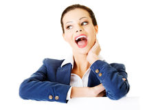 Attractive business woman sitting laughing. Royalty Free Stock Photography