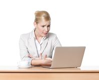 Attractive business woman sitting at a office table with laptop Stock Photo