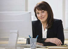 Attractive business woman smiling. Royalty Free Stock Image