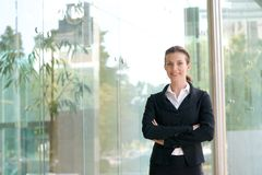 Attractive business woman smiling with arms crossed Royalty Free Stock Image