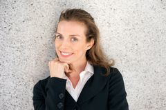 Attractive business woman smiling with hand on chin Royalty Free Stock Photo