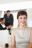 An attractive business woman smiling in the office Royalty Free Stock Photo