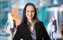 Attractive business woman smiling portrait in office Royalty Free Stock Photo