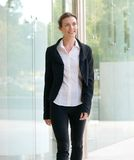 Attractive business woman smiling and walking outside Stock Photography