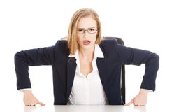 Attractive business woman by the table, bossy behaviour. Stock Photography