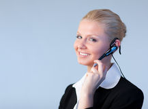 Attractive Business woman talking on a head piece Royalty Free Stock Image