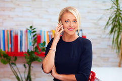 Attractive business woman talking on the phone in office Stock Image