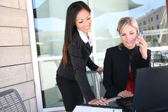 Attractive Business Woman Team on Computer Royalty Free Stock Photo