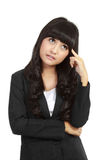 Attractive business woman thinking. Royalty Free Stock Image