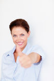 An attractive business woman with thumbs up Stock Photography