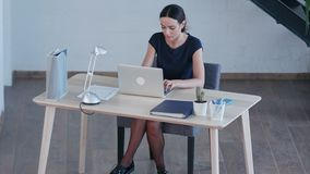 Attractive business woman use laptop in huge loft studio stock video footage