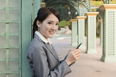 Attractive business woman use smart phone Royalty Free Stock Photography
