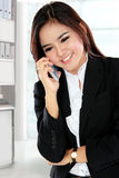 Attractive business woman using a mobile phone Stock Photography