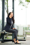 Attractive business woman waiting at bus stop Royalty Free Stock Photo
