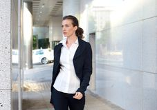 Attractive business woman walking outside Royalty Free Stock Image