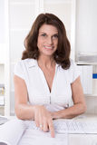 Attractive business woman in white shirt. Stock Photography