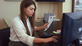 Attractive business woman working with computer in office stock video footage