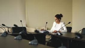 Attractive business woman working with documents in office. stock video