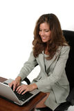 Attractive Business Woman Working On Laptop 2. Attractive executive business woman working on a laptop computer Stock Photography