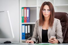 Attractive business woman working on laptop computer.  Stock Photography