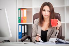 Beautiful Business woman typing on laptop. Attractive business woman working on laptop computer Stock Images