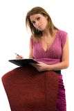 Attractive business woman writing on a notepad Stock Photography