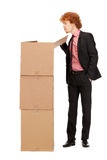 Attractive businessman with big boxes Stock Photography