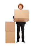 Attractive businessman with big boxes Royalty Free Stock Photography