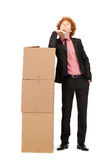 Attractive businessman with big boxes Stock Image