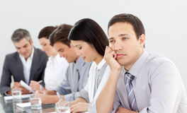 Attractive businessman bored at a presentation Stock Photography