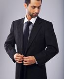 Attractive Businessman Buttoning His Coat Royalty Free Stock Photos