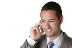 Attractive Businessman on Cell Phone. An attractive dark-hark haired man talks on a cell phone, smiling.  Against a white background Stock Photography