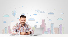 Attractive businessman with city sky-scape background Stock Image