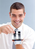 Attractive businessman consulting a directory Stock Photos
